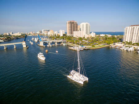 Boats and yachts passing open Drawbridge in Fort Lauderdale, Florida. Aerial view.