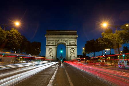 Paris Arc de Triomphe Triumphal Arch at Chaps Elysees at night, Paris, France. Architecture and landmarks of Paris. Postcard of Paris