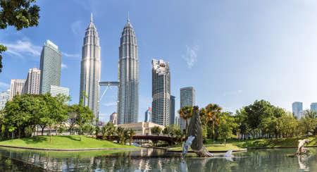 Kuala Lumpur, Malaysia - April 19, 2015: Petronas Twin towers panorama, Kuala Lumpur central park KLCC