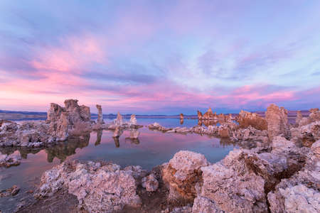 Sunset at Mono lake, California. Bizarre calcareous tufa formation on the smooth water of the lake.