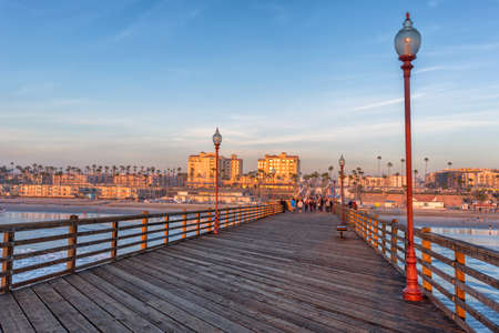 California Oceanside pier over the ocean at sunset with beach, travel destination