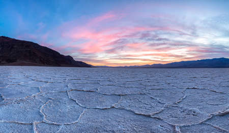 Fiery sunset over Badwater at Death Valley National Park, California
