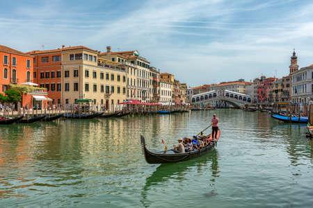 Venice, Italy - 12.06.2019: Gondolas near to the Rialto bridge on Grand canal street in Venezia