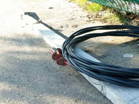 Cemented electric pipe black wire on road in jammu city