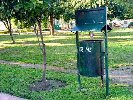 03 june 2020 Use me dustbin in public park green color iron plants also seems