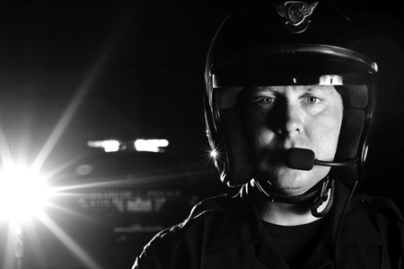motorcycle officer: a police motorcycle officer in the night.