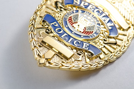 police badge: a shallow depth of field look of a generic looking police badge