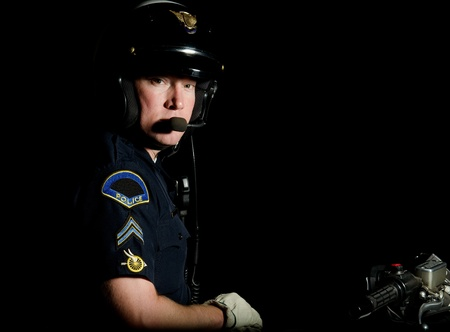 motor officer: A motorcycle police officer in the night.