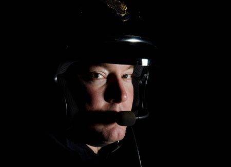 night shift: A motorcycle police officer in the night.