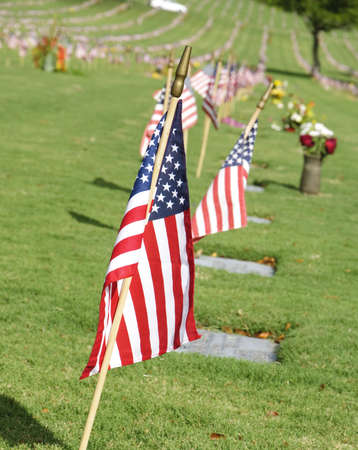 military cemetery: The flag of the United State of America at the Punchbowl National Cemetery on the Island of Oahu in Hawaii on Memorial Day. Stock Photo