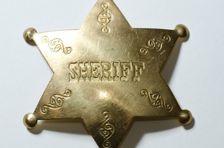 sheriffs: a close up of an old looking sheriffs badge Stock Photo