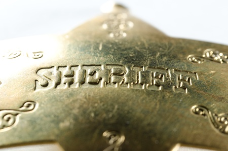 A close up of an old looking Sheriff's badge with shallow depth of field Stock Photo - 12381952