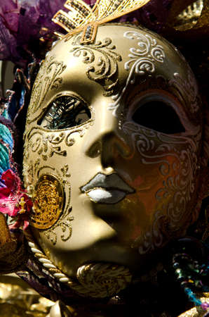 A mardi gras mask on display from an outdoor vendor photo
