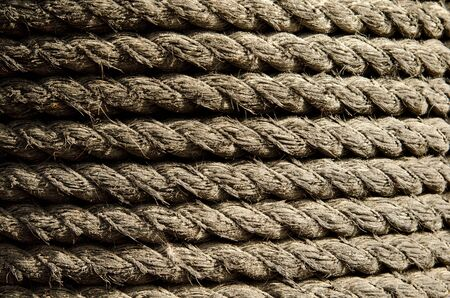 a rope coiled around a pole on a sailboat Stock Photo - 12500583