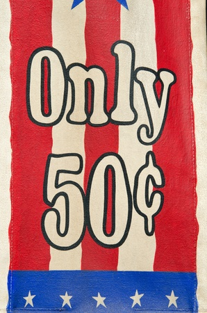 50 something: a red, white and blue sign at a shop showing that something cost 50 cents Stock Photo