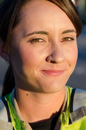 A female police officer smiles during her shift Stock Photo - 15401294