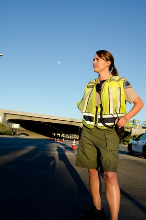 A female police officer staring and looking seus during a traffic control shift   Stock Photo - 15401272