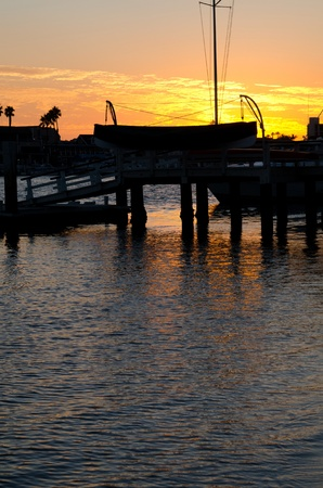 The sun setting in the harbor in Newport Beach,CA in October  photo