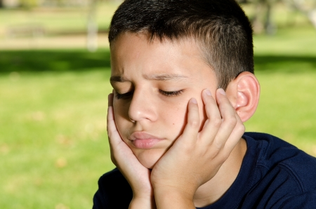 a 10 year boy looking sad and upset Stock Photo - 15691268