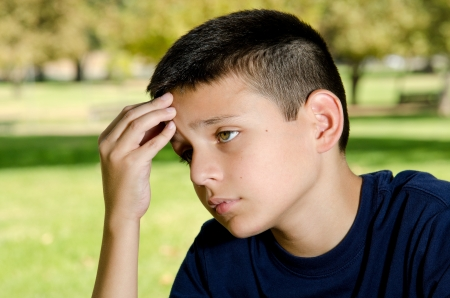 a 10 year boy looking sad and upset Stock Photo - 15691269