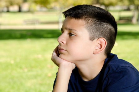 a 10 year boy looking sad and upset. Stock Photo - 15691271