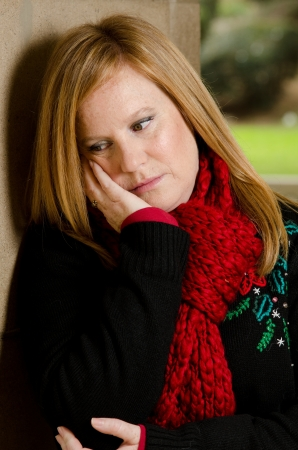 35 40 years old: a woman sitting down with a sad and depressed look on her face Stock Photo