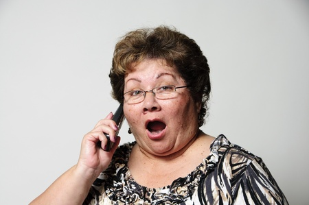 a woman getting surprising news on the phone Stock Photo - 18666390