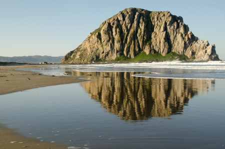 The reflection of Morro Rock in Morro Bay, CA along the Central Coast. Stock Photo - 18860259
