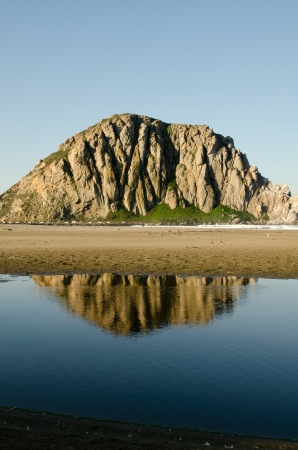 The reflection of Morro Rock in Morro Bay, CA along the Central Coast. Stock Photo - 18860260