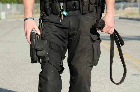 holster: A close up of a police K9 handler