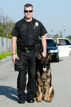 police unit: A K9 police officer with his dog.