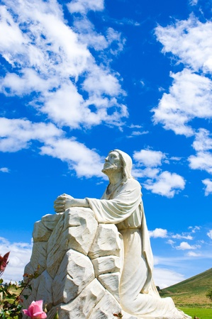 A statue of Jesus looking up at the sky at a cemetery in Riverside, CA  photo
