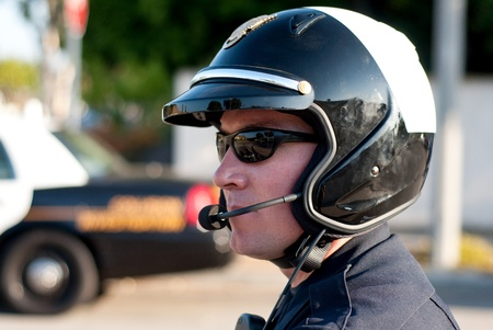 A motorcycle police officer watces traffic during his shift   photo