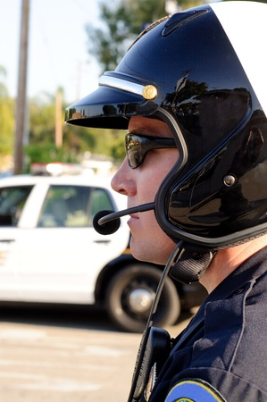 motorcycle officer: A motorcycle police officer watces traffic during his shift  Stock Photo