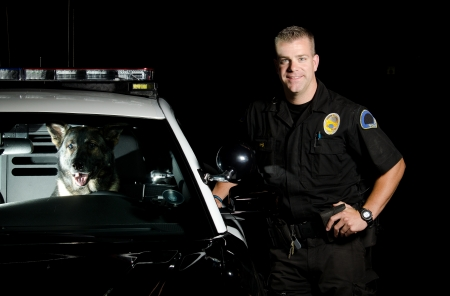 patrol officer: a K9 officer with his partner sitting in the driver seat of their patrol car   Stock Photo
