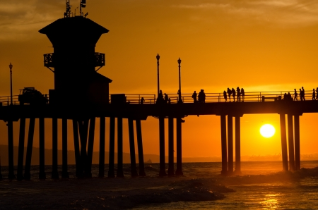 ca: The pier in Huntington Beach, CA at sunset during a summer night
