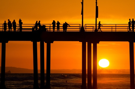 The pier in Huntington Beach, CA at sunset during a summer night Stock Photo - 21746212