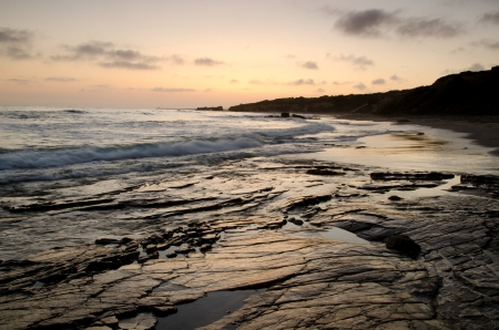 The coast at Crystal Cove State Beach in Southern California at dusk   photo