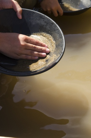 panning: A child panning for gold at a mine in Julian, CA  Stock Photo