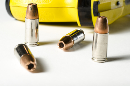 a close up of a police stun gun and bullets. Stock fotó