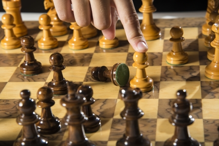 a close up of a chess board during a game   Imagens