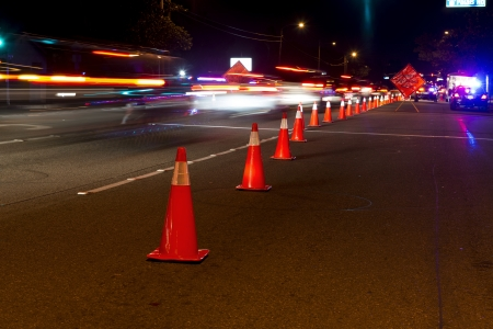 dui: Traffic cones and traffic at a DUI check point in Anaheim  Stock Photo