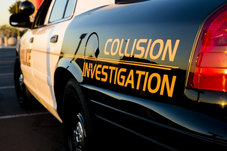 investigate: A close up of a police car that investigate traffic collisions
