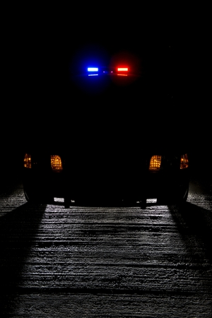 police lights: A police car at night with its lights on    low key for copy space Stock Photo