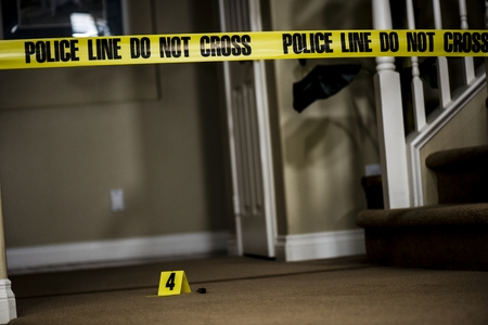 scene of a crime: The number 4 crime scene marker on the floor of a house