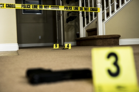 A crime scene with number markers and evidence on the floor  photo