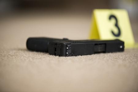 crime: a close up of a gun at a crime scene Stock Photo