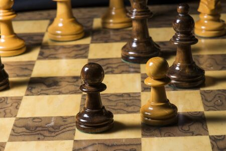 a close up of a chess game. Imagens