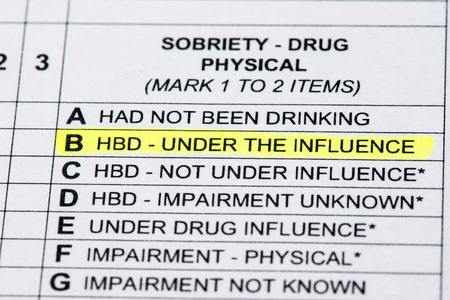 under arrest: A close up of a police report listing the DUI section