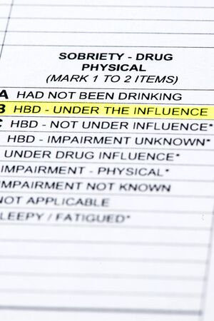 law report: A close up of a police report listing the DUI section